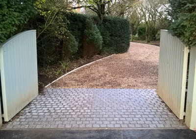 Driveway with granite setts and reinforced Sandstone car park